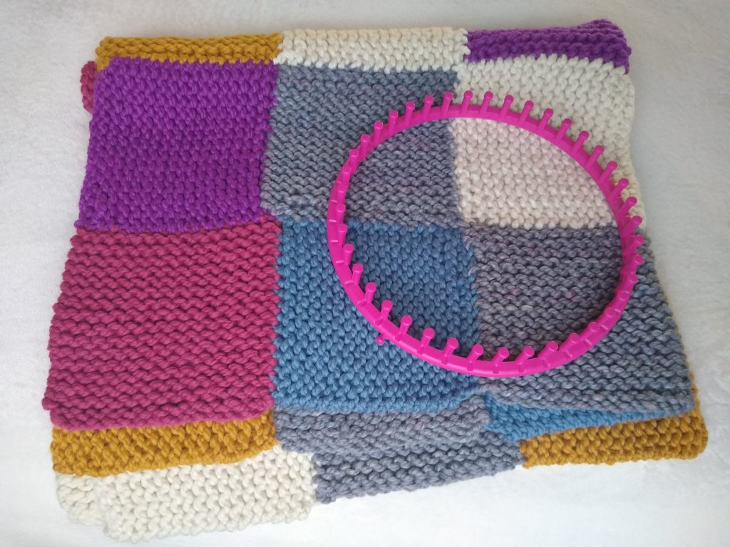 folded blanket with loom on top