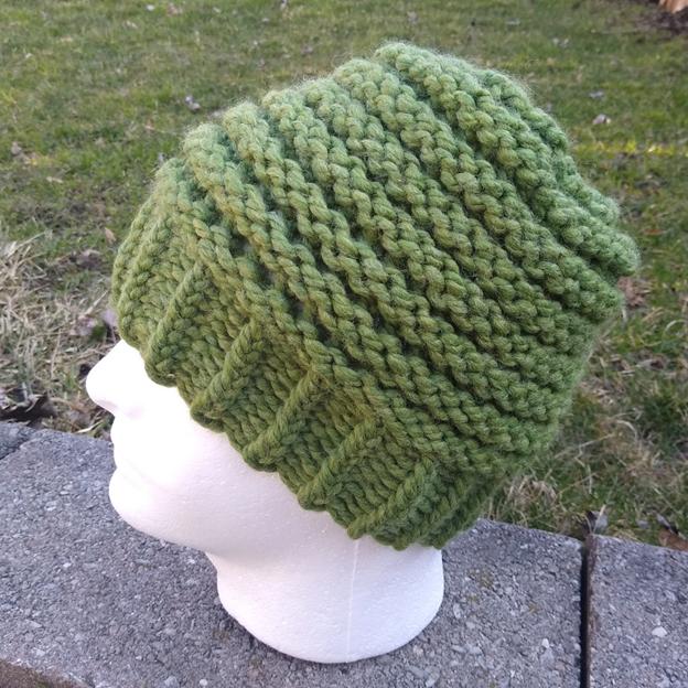green welt stitch hat on mannequin head